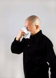 Hombre que estornuda Imagen de archivo