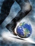 Hombre que golpea la tierra del planeta con el pie Fotos de archivo