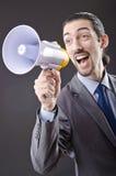 Hombre que grita con el altavoz Imagen de archivo libre de regalías