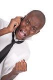 Hombre que grita en el teléfono celular Fotografía de archivo libre de regalías
