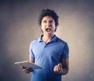 Hombre que grita hacia fuera ruidosamente Fotografía de archivo libre de regalías
