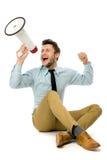 Hombre que grita a través del megáfono Foto de archivo libre de regalías