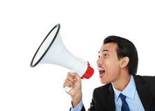 Hombre que grita usando el megáfono Imagen de archivo libre de regalías