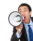 Hombre que grita usando el megáfono Imágenes de archivo libres de regalías