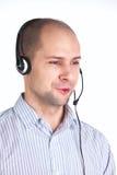Hombre que habla con el receptor de cabeza Imágenes de archivo libres de regalías