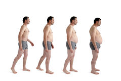 Hombre que hace aumento de peso ampliado imagen de archivo libre de regalías
