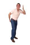 Hombre que hace el gesto grosero que indica el mán olor Imagenes de archivo
