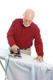 Hombre que hace planchar Fotografía de archivo libre de regalías