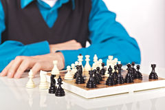 Juego de ajedrez en el fondo blanco Imagen de archivo libre de regalías