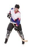 Hombre que juega a hockey Imagen de archivo libre de regalías