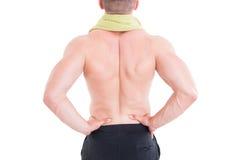 Hombre que lleva a cabo su área lumbar o más de espalda juguetón imagen de archivo libre de regalías