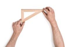 Hombre que lleva a cabo un cuadrado determinado de madera Imagen de archivo libre de regalías