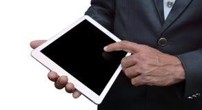 Hombre que lleva a cabo un sideview de la tableta el iPad favorable fue creado y desarrollado por Apple inc. fotografía de archivo libre de regalías