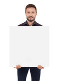 Hombre que lleva a cabo una muestra en blanco Fotografía de archivo