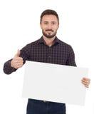 Hombre que lleva a cabo una muestra en blanco Imagen de archivo libre de regalías