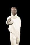 Hombre que lleva cercando el traje que practica con la espada Fotografía de archivo