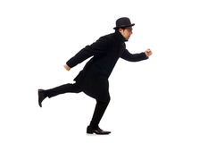 Hombre que lleva la capa negra aislada en blanco Fotografía de archivo