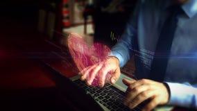Hombre que mecanografía en el teclado con el holograma del símbolo del corazón metrajes