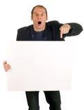 Hombre que muestra la cartelera Foto de archivo libre de regalías