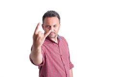 Hombre que muestra la roca o el símbolo de metales pesados Foto de archivo libre de regalías