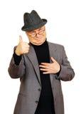 Hombre que muestra un gesto de Fotos de archivo