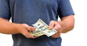 Hombre que paga con cientos cuentas de dólar Imágenes de archivo libres de regalías