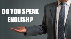 ¿Hombre que presenta la pregunta usted habla inglés? Foto de archivo
