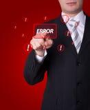 Hombre que presiona el botón del ERROR Imagen de archivo