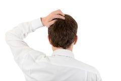 Hombre que rasguña su cabeza Imagen de archivo