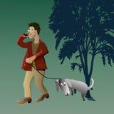 Hombre que recorre con su perro Foto de archivo libre de regalías