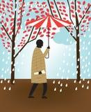 Hombre que recorre en lluvia Imagenes de archivo