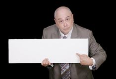 Hombre que señala a la muestra en blanco Imágenes de archivo libres de regalías