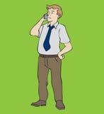 Hombre que se coloca con el teléfono Imagen de archivo