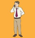 Hombre que se coloca con el teléfono Imagen de archivo libre de regalías