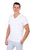 Hombre que se coloca en blanco Foto de archivo libre de regalías