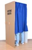 Hombre que se coloca en cabina de votación Fotos de archivo libres de regalías