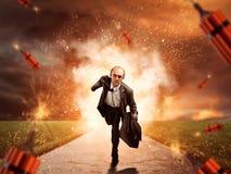 Hombre que se escapa del estallido de la dinamita foto de archivo libre de regalías