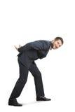 Hombre que se inclina abajo y que camina Imagenes de archivo