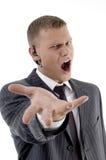 Hombre que se queja con la comunicación Imagen de archivo