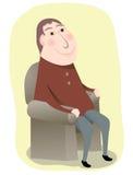 Hombre que se sienta en una silla Foto de archivo