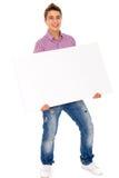 Hombre que sostiene el cartel en blanco Imágenes de archivo libres de regalías
