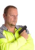 Hombre que sostiene la arma de mano Imagenes de archivo