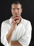 Hombre que sostiene la bola de grillo Fotos de archivo libres de regalías