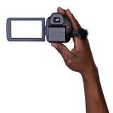 Hombre que sostiene la cámara de vídeo Fotos de archivo