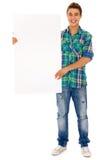 Hombre que sostiene la cartelera en blanco Fotografía de archivo libre de regalías