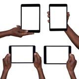 Hombre que sostiene las tabletas en blanco aisladas en blanco imagen de archivo libre de regalías