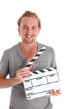 Hombre que sostiene una pizarra de la película Fotografía de archivo libre de regalías