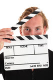 Hombre que sostiene una pizarra de la película Fotos de archivo libres de regalías