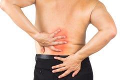 Hombre que sufre de un dolor más de espalda Imagen de archivo libre de regalías