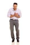 Hombre que tiene ataque del corazón fotos de archivo libres de regalías